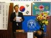 全玉勲 県韓商会長の祝賀挨拶の様子
